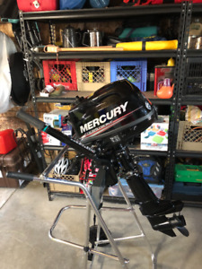 Mercury 4 hp outboard, external fuel tank, and stand - BRAND NEW