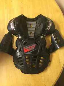 Kids/youth dirtbiking gear. Helmet, chest protector, boots, pant
