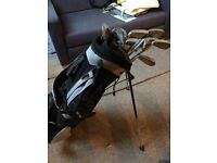 Golf clubs, bag and stand