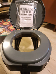 Never used Reliance Camping Toilet, with box of bags!