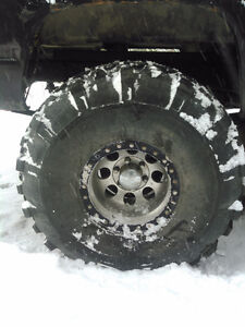 38 inch super swampers on 16 inch rims