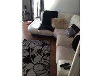 White leather corner sofa. Dfs