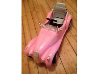 Toy pink classic sit in racing car