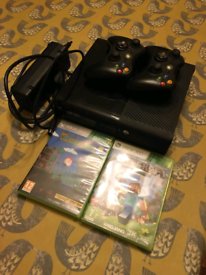 X Box 360 with 2 wireless controllers, Minecraft and Terraria.