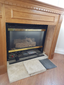 Gas Fireplace with surrounding mantle
