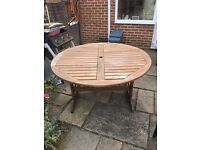 Large round wooden garden table free to a good home