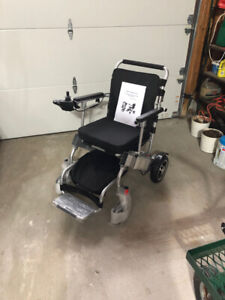 Electric Wheelchair, Portable, Collapsibe - NEW $2000.00