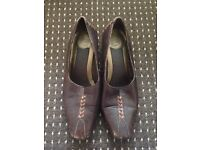 Used brown heels size 4