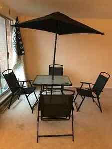 4 chairs with table and umbrella