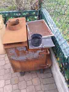 Rusty old wood burning stove with chimney