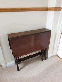 Small folding leaf table on casters