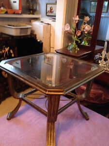 Glass topped coffee table with 2 matching end tables