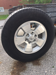 """Toyota Tacoma 17"""" Factory rims with Michelin P265/65/R17 tires."""