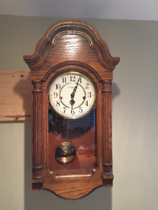 HOWARD MILLER WALL CLOCK, SOLID OAK, GREAT CONDITION.