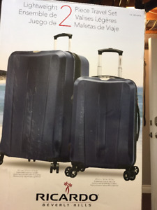 Brand new in box 2 PC Ricardo Beverly Hills luggage set.
