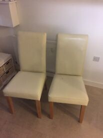 Pair cream faux leather dining room chairs