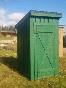 Solid rough lumber outhouse