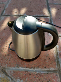 Stainless steel Cordless kettle with base stand in good working order.