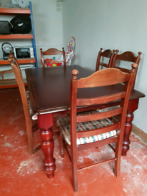Used solid Wooden Dinning table with 6 chairs mahogany