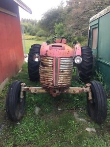 Old Massey 165? With used brush hog (with broken  blade)