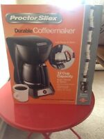 Coffee maker + filters & ground coffee
