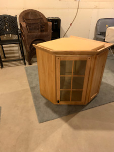 Corner kitchen cabinet with glass door
