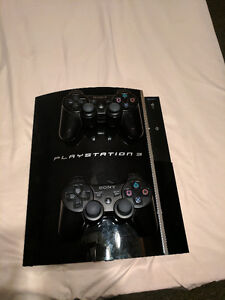 Playstation 3 two controllers and 11 games