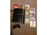 Great condition PS3 with 8 games