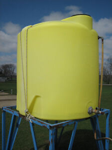 Two 500 Gallon Water Tanks with Stands