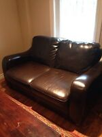Leather love seat and couch