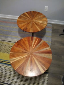 Two small identical circular coffee tables