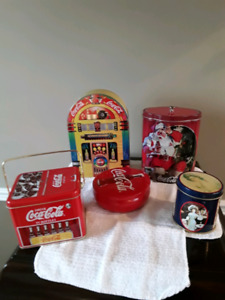 Four assorted Coke tins
