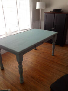 Solid wood butcher block table. Excellent condition.