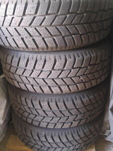 4 WINTER TIRES ON RIMS AND 5 HUBCAPS 215/60R16
