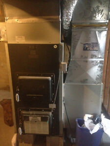 Wood/Electric furnace for sale. Must go ASAP! Contact within