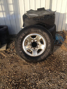 Dodge Ram 2500 rims and tires and chrome step bars
