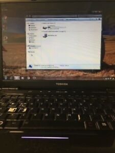 Toshiba w/ 150 gb hard drive, 3 gb ram, windows 7