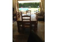 Large solid oak farmhouse style kitchen dining table and 6 matching chairs