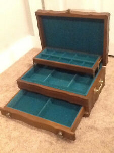 Brown jewellery box with green interior