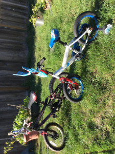 2 bikes with training wheels and 1 Spider-Man theme