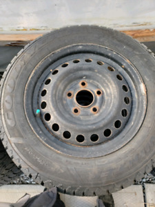 4 goodyear nordic trac 195/65/15 on 5 bolt steel rims
