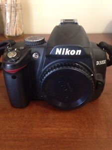 Nikon D3000 battery, battery charger and cords