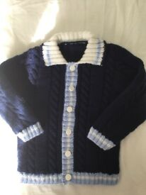 Hand knitted child's Aran jacket