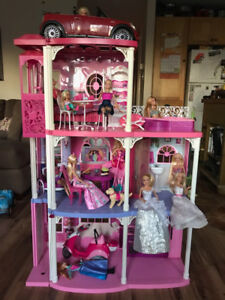 Barbie House, dolls, and car for sale