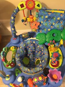 Exersaucer and tummy time play mat