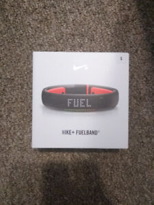 BRAND NEW - Nike  Fuelband - size small - black and orange