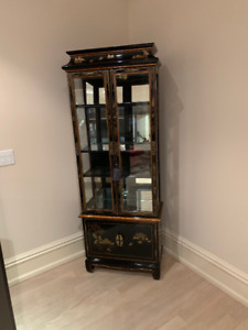 Beautiful tall display cabinet with Asian decal