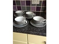 Set of 4 cups and saucers
