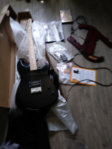 BRAND NEW GUITAR WITH STAND FOR SALE $125EXCELLENT OF ON LINE L
