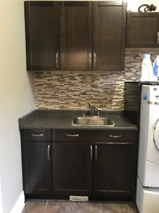 Laundry room sink and cabinets.